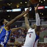 Apr 21, 2014; Los Angeles, CA, USA; Golden State Warriors forward Hilton Armstrong (57) and Los Angeles Clippers forward Glen Davis (0) go up for the ball during the fourth quarter in game two during the first round of the 2014 NBA Playoffs at Staples Center. Mandatory Credit: Richard Mackson-USA TODAY Sports