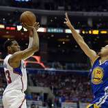 Apr 21, 2014; Los Angeles, CA, USA; Los Angeles Clippers forward Danny Granger (33) shoots against Golden State Warriors guard Stephen Curry (30) during the fourth quarter in game two during the first round of the 2014 NBA Playoffs at Staples Center. Mandatory Credit: Richard Mackson-USA TODAY Sports