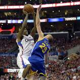 Apr 21, 2014; Los Angeles, CA, USA; Golden State Warriors guard Steve Blake (25) defends against Los Angeles Clippers guard Jamal Crawford (11) in game two during the first round of the 2014 NBA Playoffs at Staples Center. Mandatory Credit: Richard Mackson-USA TODAY Sports