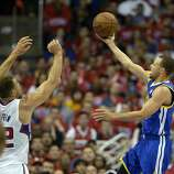 Apr 21, 2014; Los Angeles, CA, USA; Golden State Warriors guard Stephen Curry (30) shoots against Los Angeles Clippers forward Blake Griffin (32) during the third quarter in game two during the first round of the 2014 NBA Playoffs at Staples Center. Mandatory Credit: Richard Mackson-USA TODAY Sports