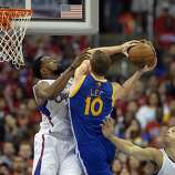 Apr 21, 2014; Los Angeles, CA, USA; Los Angeles Clippers center DeAndre Jordan (6) defends against Golden State Warriors forward David Lee (10) during the third quarter in game two during the first round of the 2014 NBA Playoffs at Staples Center. Mandatory Credit: Richard Mackson-USA TODAY Sports