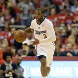 Apr 21, 2014; Los Angeles, CA, USA; Los Angeles Clippers guard Chris Paul (3) drives against the Golden State Warriors during the third quarter in game two during the first round of the 2014 NBA Playoffs at Staples Center. Mandatory Credit: Richard Mackson-USA TODAY Sports