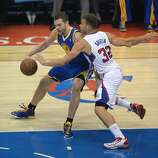 David Lee of the Golden State Warriors (L) and Los Angeles Lakers Blake Griffin challenge for the ball during Game Two of their  NBA Western Conference first-round series playoffs at the Staples Center in Los Angeles California April 21, 2014.  AFP PHOTO / ROBYN BECKROBYN BECK/AFP/Getty Images