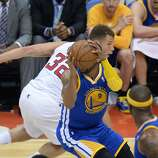 Golden State Warriors Andre Iguodala (R) steals the ball from Los Angeles Clippers Blake Griffin (L) during their  first-round NBA Western Conference playoff game at the Staples Center in Los Angeles California April 21, 2014.  AFP PHOTO / ROBYN BECKROBYN BECK/AFP/Getty Images