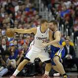 Apr 21, 2014; Los Angeles, CA, USA; Golden State Warriors forward David Lee (10) defends against Los Angeles Clippers forward Blake Griffin (32) during the second quarter in game two during the first round of the 2014 NBA Playoffs at Staples Center. Mandatory Credit: Richard Mackson-USA TODAY Sports