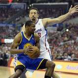 Apr 21, 2014; Los Angeles, CA, USA; Golden State Warriors guard Jordan Crawford (55) drives against Los Angeles Clippers forward Hedo Turkoglu (8) during the second quarter in game two during the first round of the 2014 NBA Playoffs at Staples Center. Mandatory Credit: Richard Mackson-USA TODAY Sports
