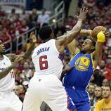 Apr 21, 2014; Los Angeles, CA, USA; Los Angeles Clippers center DeAndre Jordan (6) defends against Golden State Warriors forward Andre Iguodala (9) during the first quarter in game two during the first round of the 2014 NBA Playoffs at Staples Center. Mandatory Credit: Richard Mackson-USA TODAY Sports