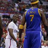 Los Angeles Clippers guard Chris Paul looks at Golden State Warriors center Jermaine O'Neal after he was fouled by him during the first half in Game 2 of an opening-round NBA basketball playoff series in Los Angeles, Monday, April 21, 2014. (AP Photo/Chris Carlson)