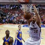 Los Angeles Clippers forward Blake Griffin, right, dunks as Golden State Warriors forward Harrison Barnes, left, and Klay Thompson look on during the second half in Game 2 of an opening-round NBA basketball playoff series in Los Angeles, Monday, April 21, 2014. (AP Photo/Chris Carlson)