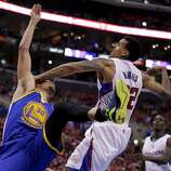 Los Angeles Clippers forward Matt Barnes, right, fouls Golden State Warriors guard Stephen Curry during the second half in Game 2 of an opening-round NBA basketball playoff series in Los Angeles, Monday, April 21, 2014. (AP Photo/Chris Carlson)
