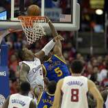 Apr 21, 2014; Los Angeles, CA, USA; Golden State Warriors forward Marreese Speights (5) shoots against Los Angeles Clippers forward Glen Davis (0) during the fourth quarter in game two during the first round of the 2014 NBA Playoffs at Staples Center. Mandatory Credit: Richard Mackson-USA TODAY Sports