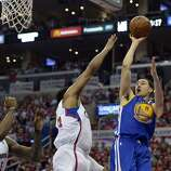 Apr 21, 2014; Los Angeles, CA, USA; Golden State Warriors guard Klay Thompson (11) shoots against Los Angeles Clippers guard Chris Paul (3) during the second quarter in game two during the first round of the 2014 NBA Playoffs at Staples Center. Mandatory Credit: Richard Mackson-USA TODAY Sports