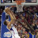 Apr 21, 2014; Los Angeles, CA, USA; Los Angeles Clippers forward Blake Griffin (32) shoots against Golden State Warriors forward Draymond Green (23) during the first quarter in game two during the first round of the 2014 NBA Playoffs at Staples Center. Mandatory Credit: Richard Mackson-USA TODAY Sports