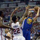 Apr 21, 2014; Los Angeles, CA, USA; Golden State Warriors guard Klay Thompson (11) shoots over Los Angeles Clippers forward Matt Barnes (22) in the first quarter in game two during the first round of the 2014 NBA Playoffs at Staples Center. Mandatory Credit: Richard Mackson-USA TODAY Sports