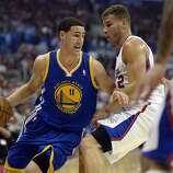 Apr 21, 2014; Los Angeles, CA, USA; Golden State Warriors guard Klay Thompson (11) drives against Los Angeles Clippers forward Blake Griffin (32) during the first quarter in game two during the first round of the 2014 NBA Playoffs at Staples Center. Mandatory Credit: Richard Mackson-USA TODAY Sports