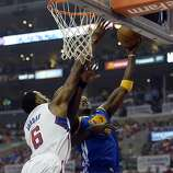 Apr 21, 2014; Los Angeles, CA, USA; Golden State Warriors center Jermaine O'Neal (7) shoots against Los Angeles Clippers center DeAndre Jordan (6) during the first quarter in game two during the first round of the 2014 NBA Playoffs at Staples Center. Mandatory Credit: Richard Mackson-USA TODAY Sports