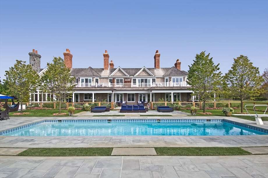 The rear exterior and heated gunite pool with underwater stereo Photo: The Corcoran Group
