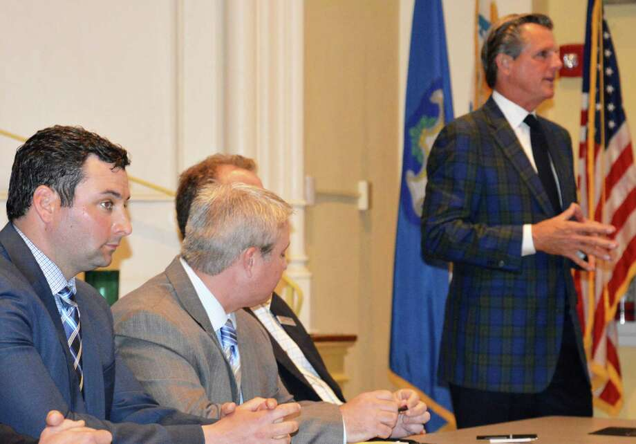 Ryan Segrue, left, the new superintendent of Longshore Golf Course -- accompanied by fellow ValleyCrest Golf Maintenance officials -- addressed town officials and golfers Monday on the firm's plans to improve upkeep at the course. Photo: Jarret Liotta / Westport News