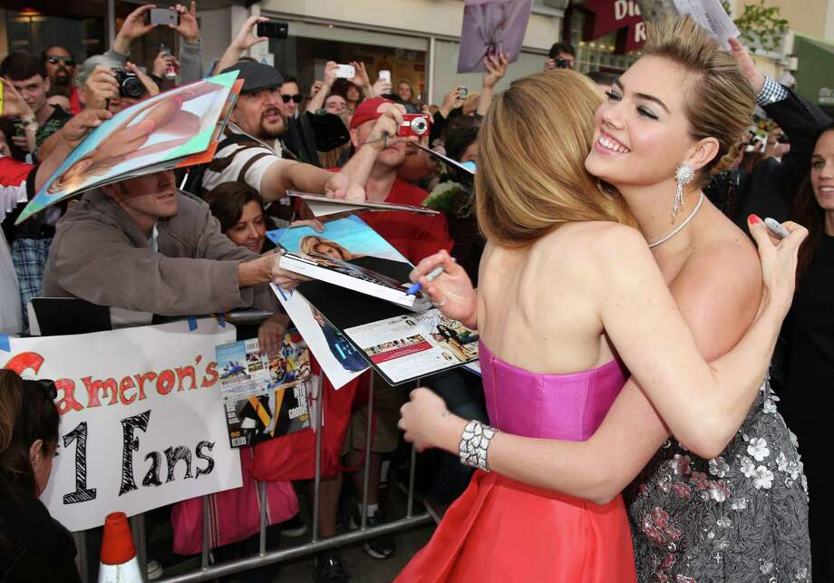 "Leslie Mann, left, and Kate Upton hug as they arrive at the Los Angeles premiere of ""The Other Woman"" at the Regency Village Westwood on Monday, April 21, 2014. Photo: Matt Sayles, AP / AP2014"
