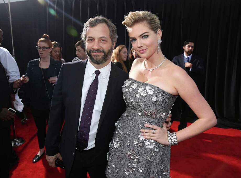 "Judd Apatow, left, and Kate Upton arrive at the Los Angeles premiere of ""The Other Woman"" at the Regency Village Westwood on Monday, April 21, 2014. Photo: Matt Sayles, AP / AP2014"