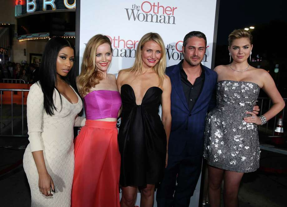 "Nicki Minaj and from left, Leslie Mann, Cameron Diaz, Taylor Kinney and Kate Upton arrive at the Los Angeles premiere of ""The Other Woman"" at the Regency Village Westwood on Monday, April 21, 2014. Photo: Matt Sayles, AP / AP2014"