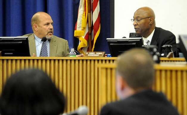 """Board Member Tom Neild and Superintendent Dr. Carrol Thomas discuss the need for an information gathering panel to investigate the feasibility of partnering with private business to build a hotel and event center near the site of the the Dr. Carrol A """"Butch"""" Thomas Educational Complex during the school board meeting at the BISD Administration Building in Beaumont, Thursday. Tammy McKinley/The Enterprise Photo: TAMMY MCKINLEY, MBR / Beaumont"""