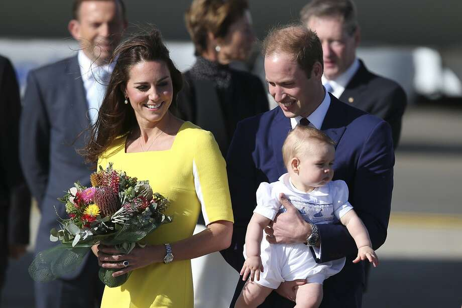 Their Royal Highnesses Prince William right, Kate, Duchess of Cambridge, and Prince George walk on the tarmac after they arrived in Sydney,  Australia, Wednesday, April 16, 2014. The Duke and Duchess of Cambridge are on a three-week tour of Australia and New Zealand, the first official trip overseas with their son, Prince George. Photo: Rob Griffith, Associated Press