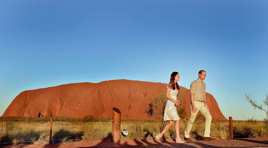 Catherine, Duchess of Cambridge and Prince William, Duke of Cambridge pose in front of Uluru, also known as Ayers Rock, on April 22, 2014 in Ayers Rock, Australia. The Duke and Duchess of Cambridge are on a three-week tour of Australia and New Zealand, the first official trip overseas with their son, Prince George of Cambridge. Photo: Pool, Getty Images