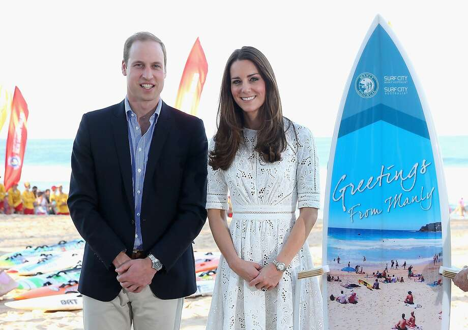 Catherine, Duchess of Cambridge and Prince William, Duke of Cambridge pose with a surfboard they were given as they attend a lifesaving event on Manley Beach on April 18, 2014 in Sydney, Australia. The Duke and Duchess of Cambridge are on a three-week tour of Australia and New Zealand, the first official trip overseas with their son, Prince George of Cambridge. Photo: Chris Jackson, Getty Images