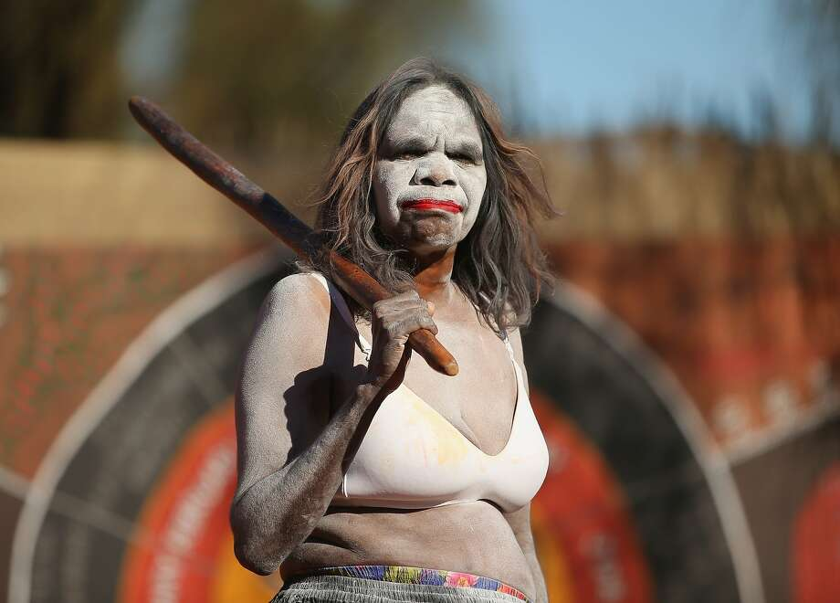 An Aboriginal woman performs for Catherine, Duchess of Cambridge and Prince William, Duke of Cambridge at the National Indigenous Training Academy on April 22, 2014 in Ayers Rock, Australia. The Duke and Duchess of Cambridge are on a three-week tour of Australia and New Zealand, the first official trip overseas with their son, Prince George of Cambridge. Photo: Scott Barbour, Getty Images