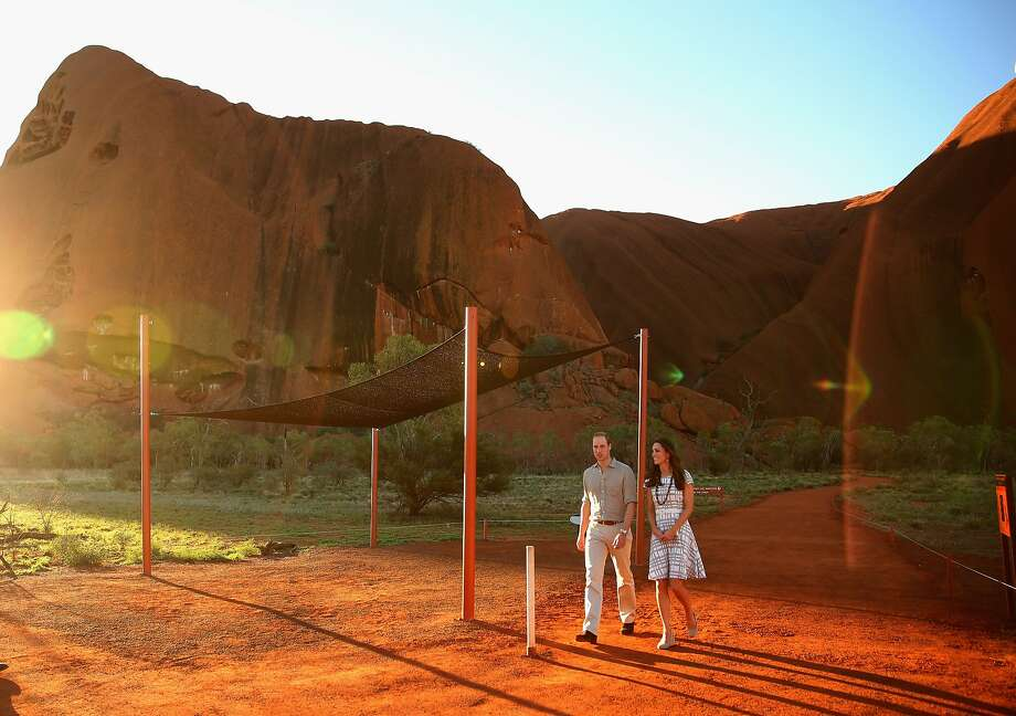 Catherine, Duchess of Cambridge and Prince William, Duke of Cambridge walk down Kuniya Walk at the base of Uluru on April 22, 2014 in Ayers Rock, Australia. The Duke and Duchess of Cambridge are on a three-week tour of Australia and New Zealand, the first official trip overseas with their son, Prince George of Cambridge.  Photo: Scott Barbour, Getty Images