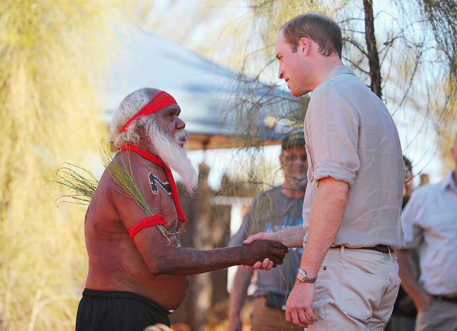 Prince William, Duke of Cambridge shakes hands with a Aboriginal man as they arrive at the Cultural Centre, Uluru-Kata Tjuta National Park April 22, 2014 in Ayers Rock, Australia. The Duke and Duchess of Cambridge are on a three-week tour of Australia and New Zealand, the first official trip overseas with their son, Prince George of Cambridge. Photo: Scott Barbour, Getty Images
