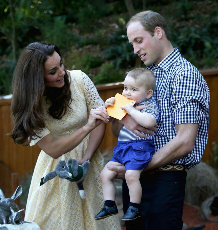 Prince William, Duke of Cambridge holds  Prince George of Cambridge as Catherine, Duchess of Cambridge gives him a commemorative card during a visit to the Bilby Enclosure at Taronga Zoo on April 20, 2014 in Sydney, Australia. The Duke and Duchess of Cambridge are on a three-week tour of Australia and New Zealand, the first official trip overseas with their son, Prince George of Cambridge. Photo: Chris Jackson, Getty Images