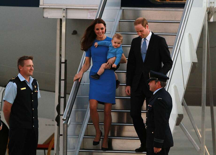 Catherine, Duchess of Cambridge, Prince William, Duke of Cambridge and their son Prince George of Cambridge arrive at Fairbairn Airport on April 20, 2014 in Canberra, Australia. The Duke and Duchess of Cambridge are on a three-week tour of Australia and New Zealand, the first official trip overseas with their son, Prince George of Cambridge. Photo: Cole Bennetts, Getty Images
