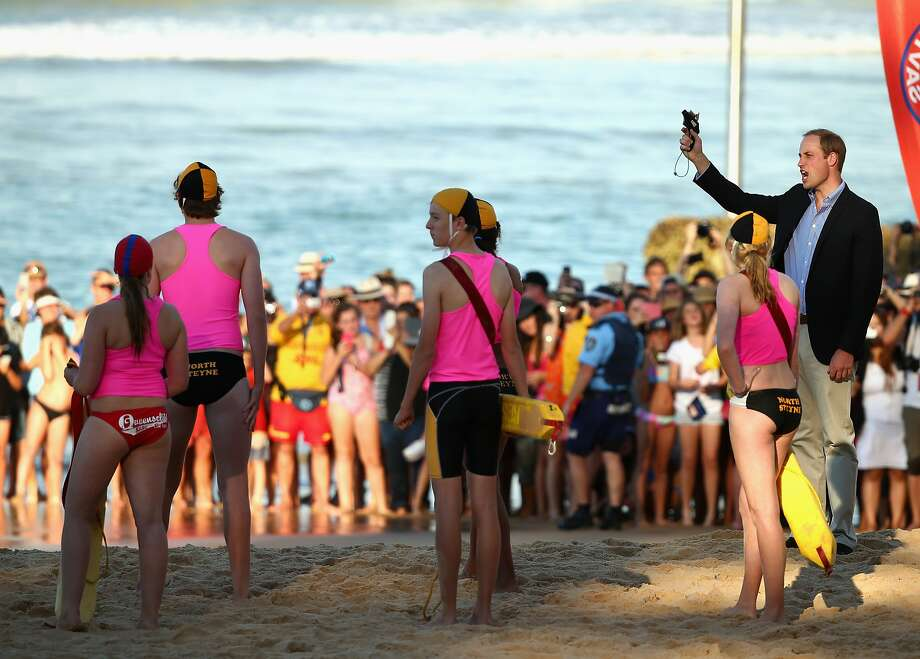Prince William, Duke of Cambridge, fires a starting gun while watching a Surf Life Saving demonstration at Manly Beach on April 18, 2014 in Sydney, Australia. The Duke and Duchess of Cambridge are on a three-week tour of Australia and New Zealand, the first official trip overseas with their son, Prince George of Cambridge. Photo: Ryan Pierse, Getty Images