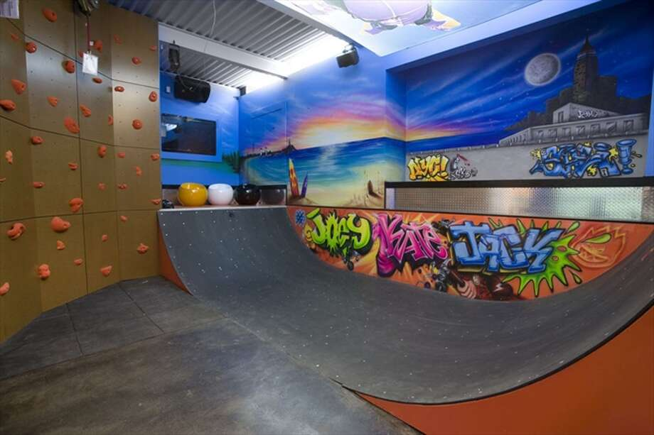 The game room, with half-pipe and climbing wall Photo: The Corcoran Group
