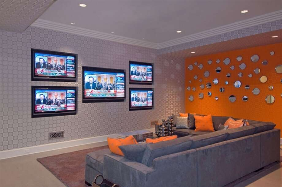 The media room with five plasma screen TVs. Photo: The Corcoran Group
