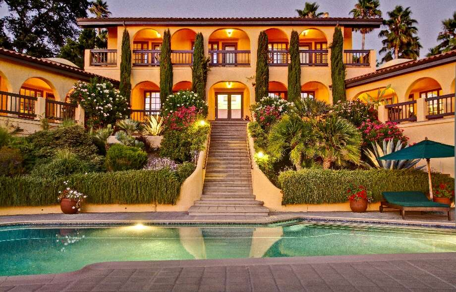 A view of the Italian-inspired home from the heated saltwater pool Photo: Randy Knight
