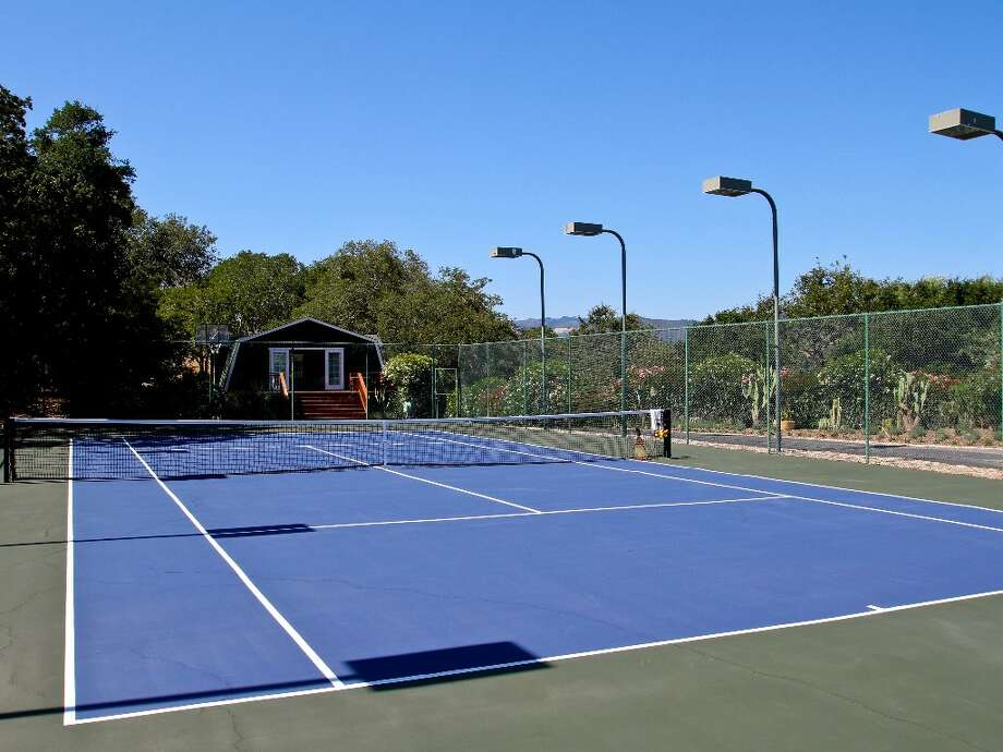 The lighted tennis court has views of the bay. Photo: Randy Knight