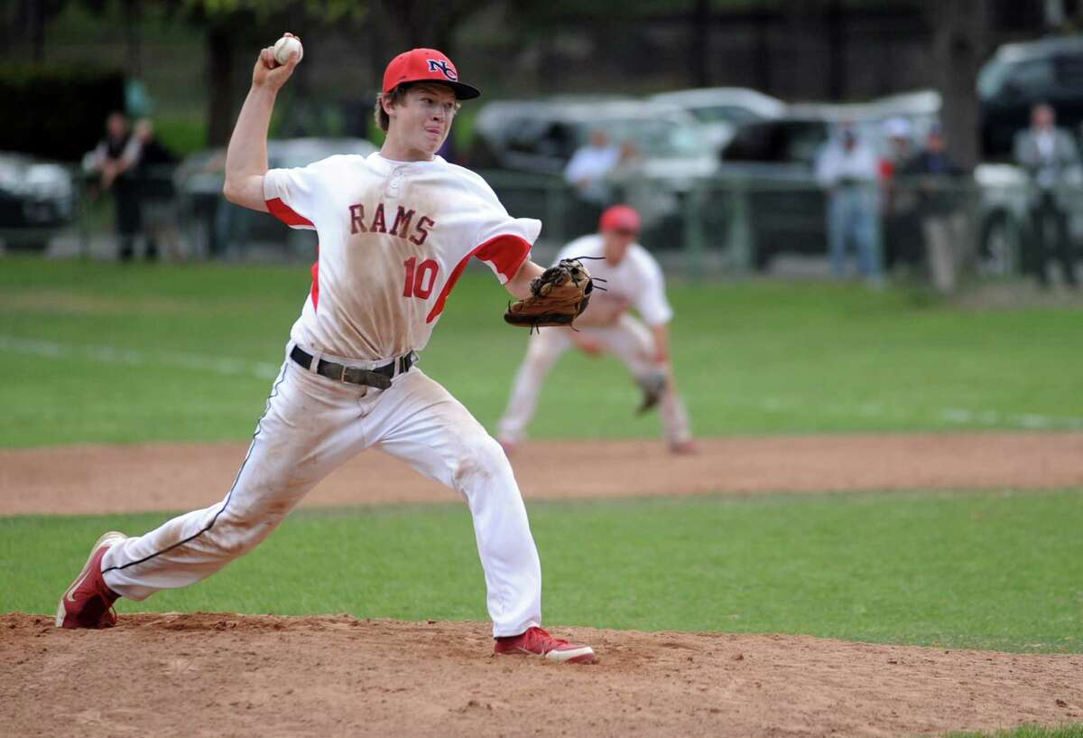 New Canaan's Dan Rajkowski pitches during a game against Staples at Mead Park in New Canaan on April 20, 2012.