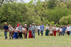 Families pull handcarts April 18 at the San Antonio West Stake Pioneer Trek at McGimsey Boy Scout Park. Approximately 180 Mormon youths participated.