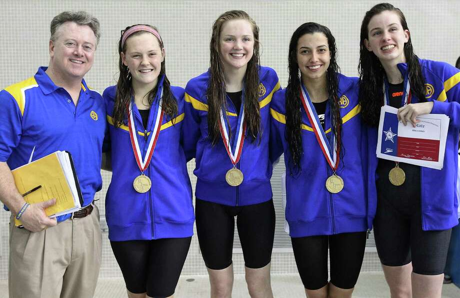 The Alamo Heights girls 200-yard relay team of Lauren Cuda, (second from left), Anelise Diener, Elizabeth Ryan and Ellery Parish join their swim coach Don Walker after they received their gold medals for finishing first in the race and setting a state record for the 200-yard relay at the UIL Swimming and Diving Championships in Austin on Saturday, Feb. 22, 2014. Photo: Kin Man Hui, San Antonio Express-News / ©2013 San Antonio Express-News
