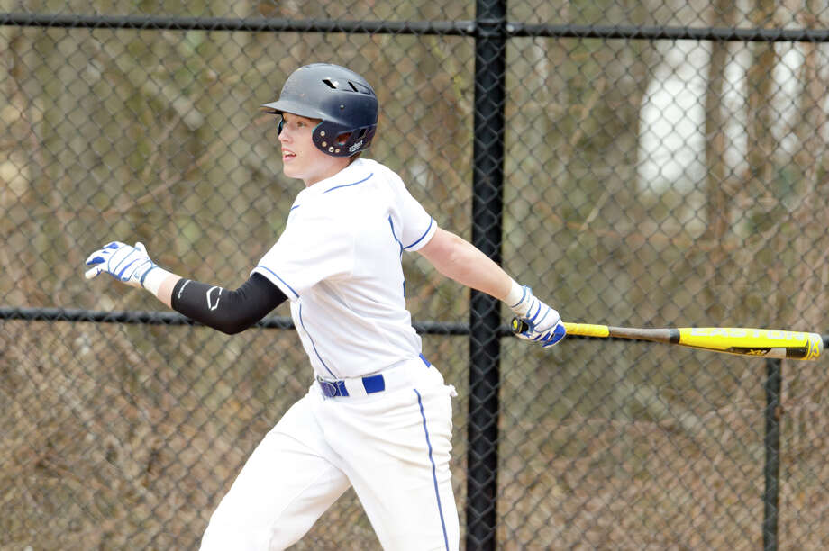 Darien's Daly Hebert stands at bat during a Blue Wave baseball game against Fairfield Ludlowe at Darien High School on Monday, April 14. Photo: Amy Mortensen / Connecticut Post Freelance