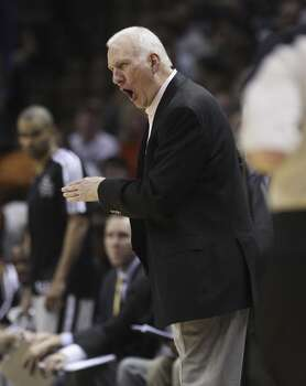 Spurs coach Gregg Popovich advises his team on the floor against the Phoenix Suns in the second half at the AT&T Center on Friday, Apr. 11, 2014. Spurs defeated the Suns, 112-104, and clinches home court advantage throughout the playoffs. (Kin Man Hui/San Antonio Express-News) Photo: Kin Man Hui, San Antonio Express-News