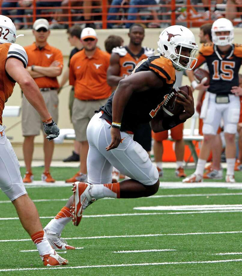 Texas quarterback Tyrone Swoopes (18) runs the ball during the first half of the Orange and White spring NCAA college football game, Saturday, April 19, 2014, in Austin, Texas. (AP Photo/Michael Thomas) Photo: Michael Thomas, Associated Press / FR65778 AP