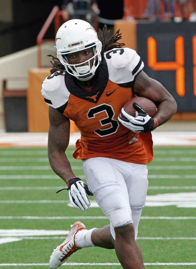 Texas running back Jalen Overstreet (3) runs the ball during the second half of the Orange and White spring NCAA college football game on Saturday, April 19, 2014, in Austin, Texas. (AP Photo/Michael Thomas) Photo: Michael Thomas, Associated Press / FR65778 AP
