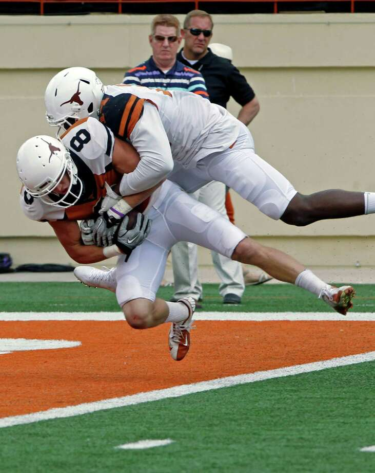Texas receiver Jaxon Shipley (8) catches a touchdown pass against Chevoski Collins during the second half of the Orange and White spring NCAA college football game on Saturday, April 19, 2014, in Austin, Texas. (AP Photo/Michael Thomas) Photo: Michael Thomas, Associated Press / FR65778 AP