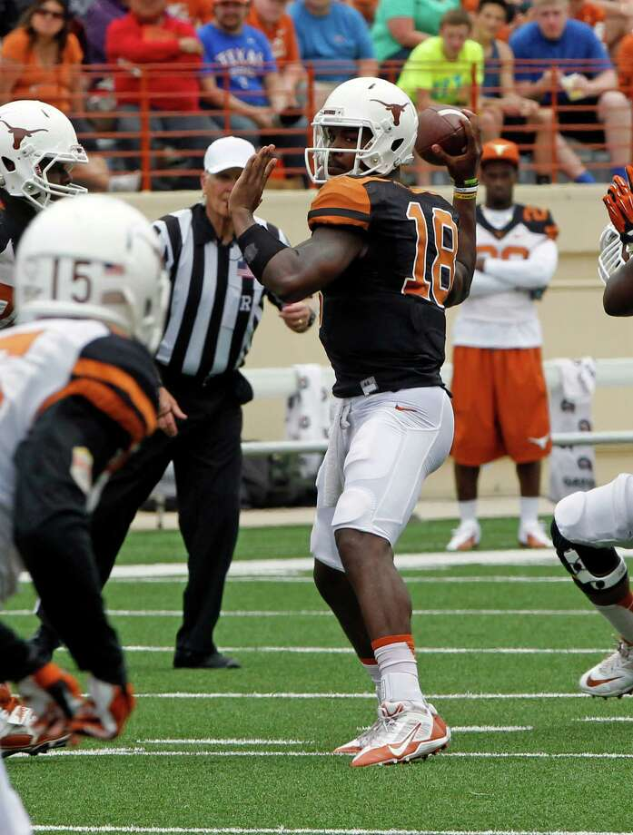 Texas quarterback Tyrone Swoopes (18) looks to throw during the first half of the Orange and White spring NCAA college football game on Saturday, April 19, 2014, in Austin, Texas. (AP Photo/Michael Thomas) Photo: Michael Thomas, Associated Press / FR65778 AP