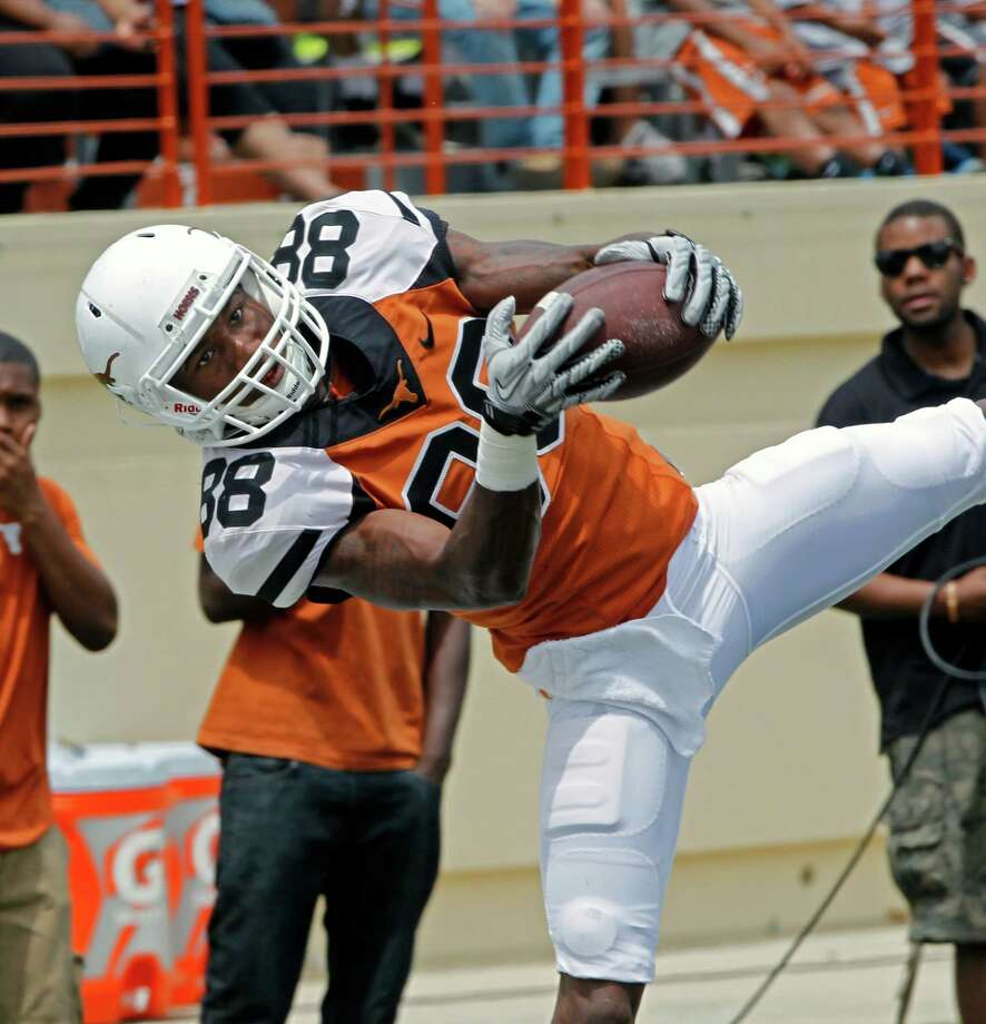 Texas receiver Montrel Meander comes down with a pass during the first half of Texas' Orange and White spring NCAA college football game, Saturday, April 19, 2014, in Austin, Texas.  (AP Photo/Michael Thomas) Photo: Michael Thomas, Associated Press / FR65778 AP