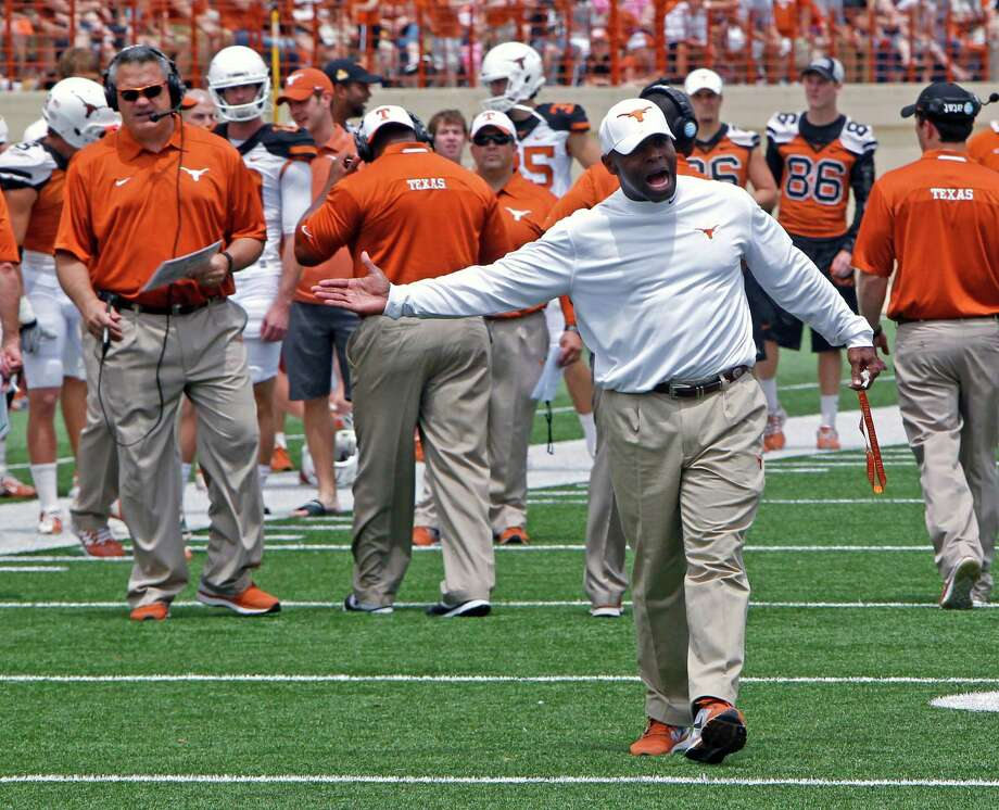 Texas coach Charlie Strong calls out to his players during the first half of the team's Orange and White spring NCAA college football game, Saturday, April 19, 2014, in Austin, Texas.  (AP Photo/Michael Thomas) Photo: Michael Thomas, Associated Press / FR65778 AP